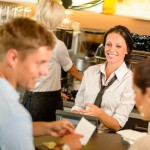 bigstock-Couple-paying-bill-at-cafe-cas-37050676
