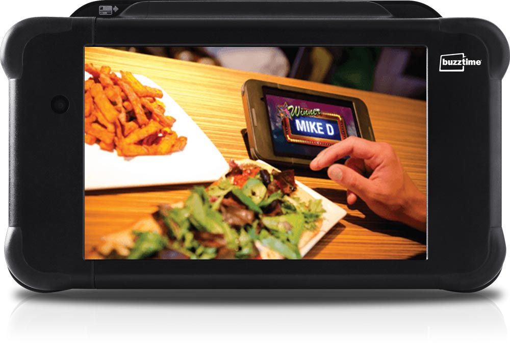 Food on Table with Tablet that has Winner on the screen