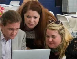 Chris Wilson, Ashley Simpkins and Trish Macri check out the results of Round Two.
